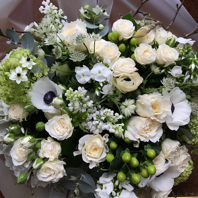A Bouquet Of White Spring Flowers Like Lilac Black Eye Anemones